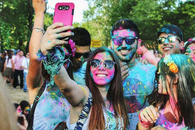 People taking selfie after color run